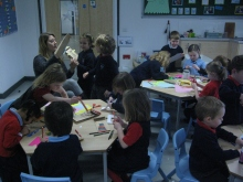 Year 2 students hard at work creating puppets with Bee and Joel