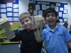 Two students enjoy showing off their hand made puppets!