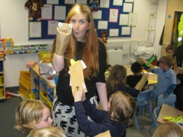 Bee Daws, one of our puppetry tutors, demonstrates to students.